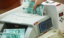 Tiền NHTW Trung Quốc bơm ròng để cứu thanh khoản tương đương ⅔ tổng nợ của Evergrande