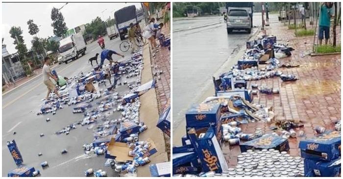 Người dân đội mưa giúp xe chở bia gặp nạn
