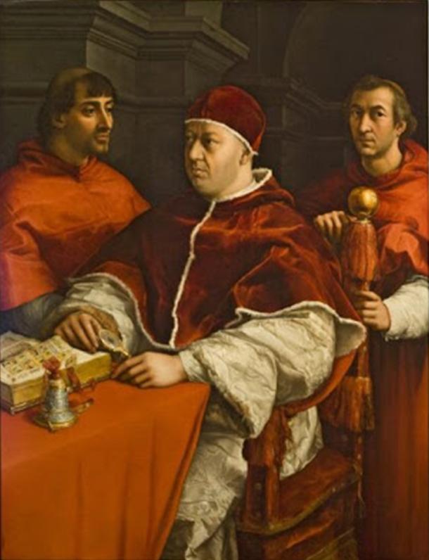 Chân dung Giáo hoàng Leo X giữa Hồng y Giulio de' Medici (Trái) và Luigi de' Rossi, vẽ bởi Raphael năm 1518 - 1519. Sơn dầu trên bảng gỗ. Gallery Tượng và Tranh tại Phòng Trưng Bày Uffizi, Florence, Ý. Tác phẩm được khôi phục dưới sự hỗ trợ của Lottomatica Holding. (Nội các Phòng Trưng Bày Uffizi / Được phép của Bộ Di Sản và Hoạt Động Văn Hóa và Du Lịch)