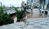 Khoảnh khắc kinh hoàng: Hố sụt khổng lồ ở Trung Quốc nuốt chửng 21 chiếc ô tô