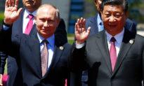 Sau cuộc khẩu chiến Mỹ-Nga, Ngoại trưởng Nga đến thăm Trung Quốc với lời kêu gọi giảm sử dụng đồng đô-la Mỹ