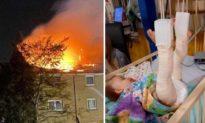 Người cha dũng cảm nhảy từ trên cao xuống đất để bắt lấy vợ con trong vụ hỏa hoạn
