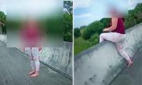 Thấy cô gái 'quẫn trí' chuẩn bị nhảy khỏi cầu, các cảnh sát lập tức hành động