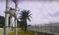 TQ dựng hàng rào gai thép nối điện cao thế ở biên giới để ngăn người Việt tràn sang khi dịch mất kiểm soát