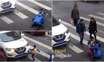 Video: Mẹ bị ô tô tông trúng, cậu bé tức giận lao đến đáp trả chiếc xe để bảo vệ mẹ
