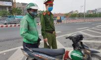 Hà Nội: Ghi nhận 12 ca mắc mới ngày 14/10, chưa cho xe ôm hoạt động vì khó truy vết